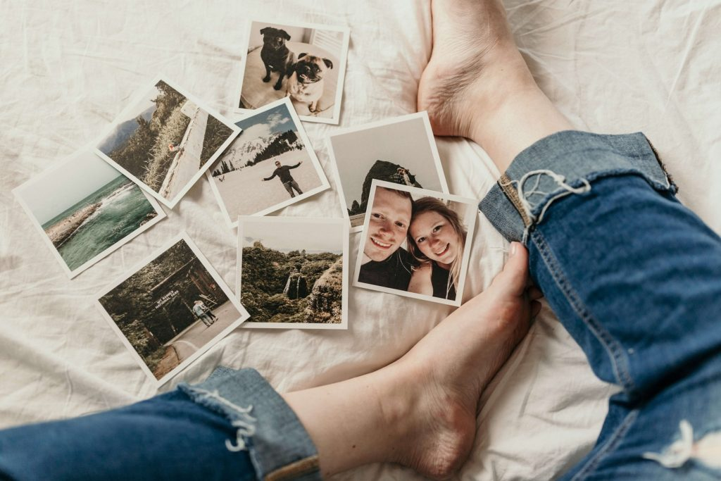 Pictures spread out by someone's feet