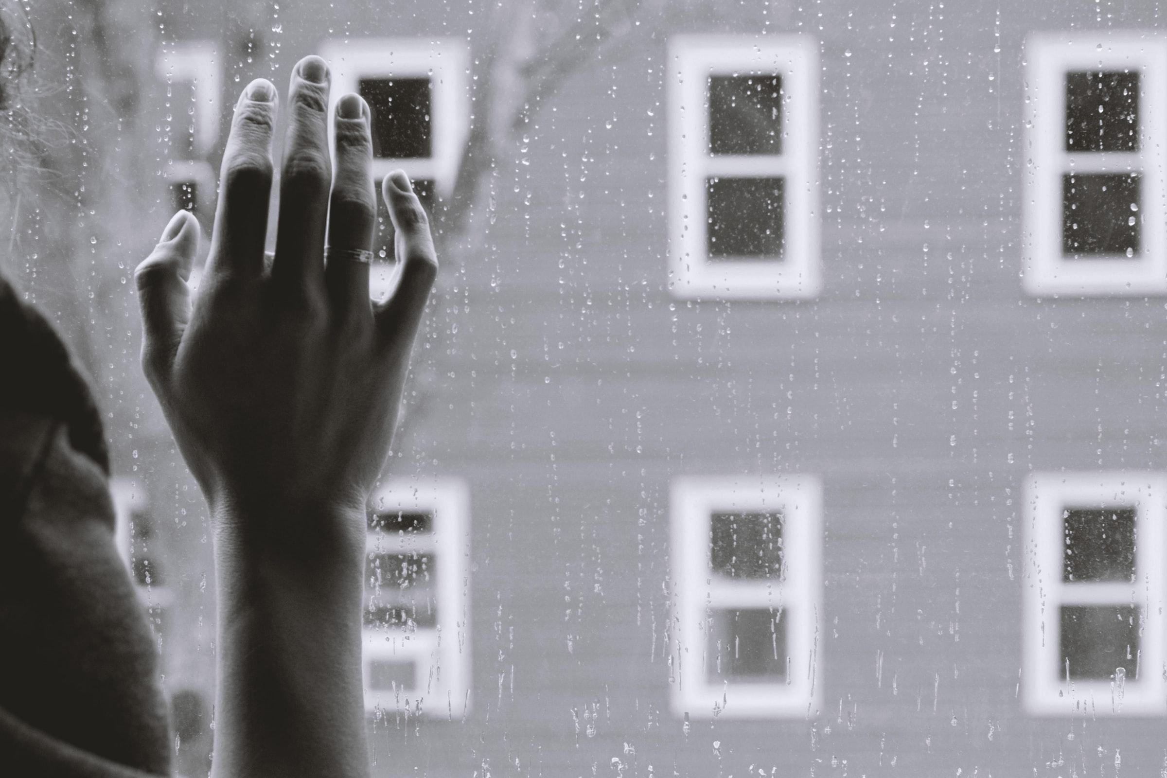 Hand on window