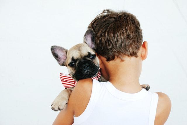 A boy hugging his dog